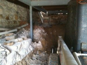 digging out a basement removing sandstone support wall before
