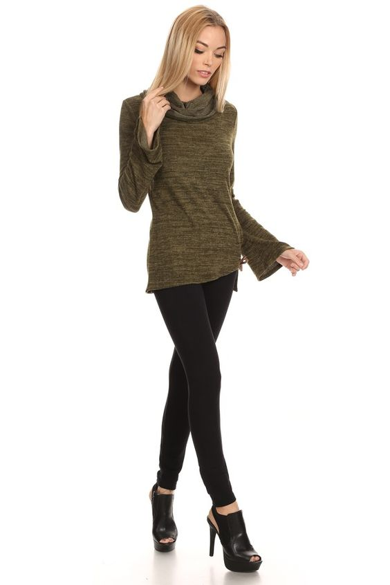 Solid, waist length long sleeve top in a relaxed style with a turtleneck and a slight hi-lo hem