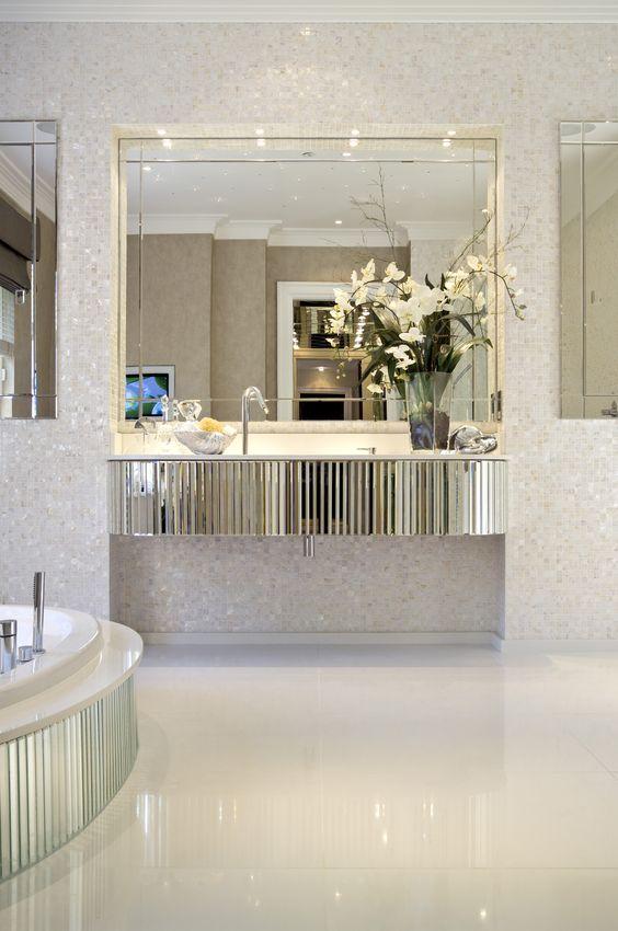 bevelled mirror floating vanity unit and semisunken bath create art deco glamour in master bathroom hill house interiors dom house pinterest