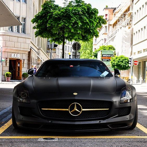 #BlackandGold John Player Special in Zurich- Mercedes Benz SLS Matt Black with Gold Essence.