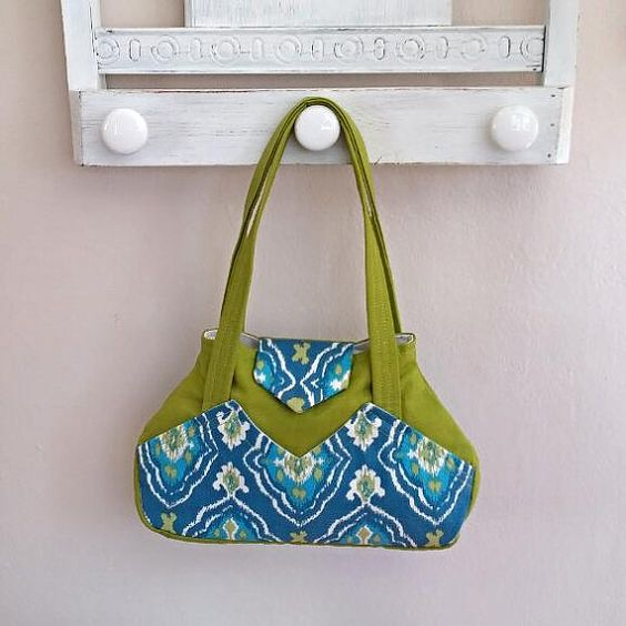 Adorable purse!  https://www.etsy.com/listing/230192473/modern-purse-urban-bag-tote-over