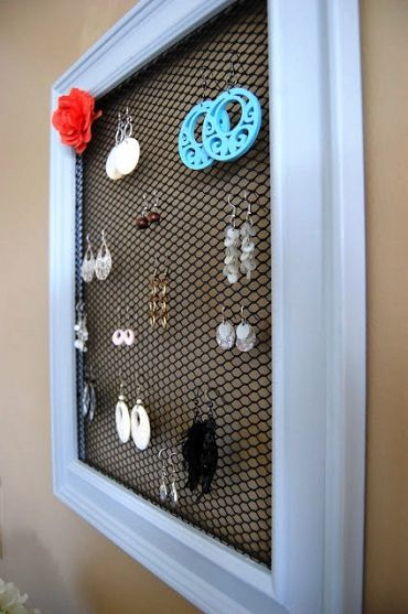 I did something similar, but used needlework plastic as my backing. Then I put 3 frames together vertically.