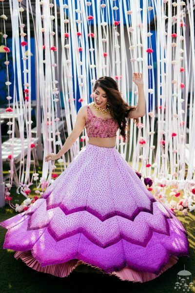 Twirling bride wearing lotus inspired lavender lehenga for mehendi. See more on wedmegood.com #wedmegood #indianwedding #indianbride #pink #lehenga #lehengacholi #bridallehenga #bridallehengacholi