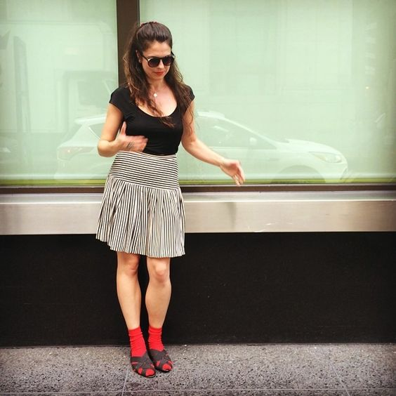 Red socks & sandals. Thrifted skirt. Red barrette & lips. #BabaChic #socksandsandals