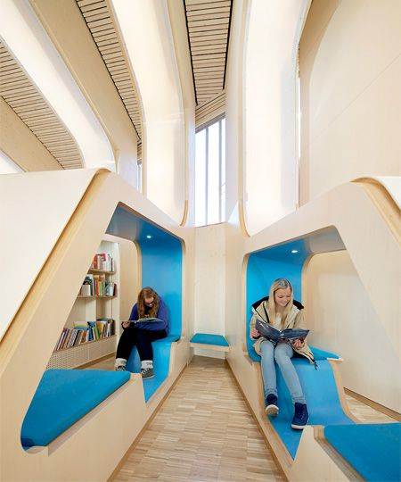 Beautiful public library designed by Helen & Hard Architects located in the downtown of Vennesla #Norway | Unique interior of the Vennesla Library and Culture House consists of 27 wooden ribs that form bookshelves and comfortable reading benches | Large windows let in plenty of light and provide beautiful views