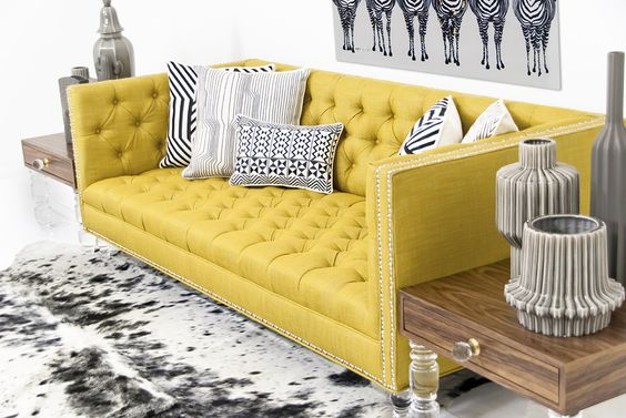 Add some swank and modern Hollywood glamor to your living room with this beautiful Old Gold Linen Hollywood sofa. You and your guests will lounge in style on this sofa finished in luxurious tufted yel
