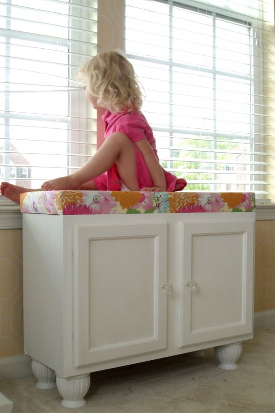 Storage bench from kitchen cabinets -add some feet, add a top with fabric covered foam and voila!