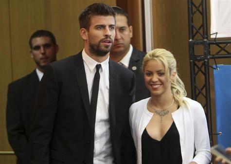 Colombian pop star and UNICEF ambassador, Shakira, walks with her boyfriend, Barcelona soccer player Gerard Pique