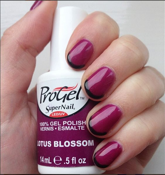 French Tips look exotic in a wide range of colors! @helen_s06 used 'Lotus Blossom' #progel polish and added black tips. Classy!  #manicure #mani #frenchtip #supernail #supernailprofessional