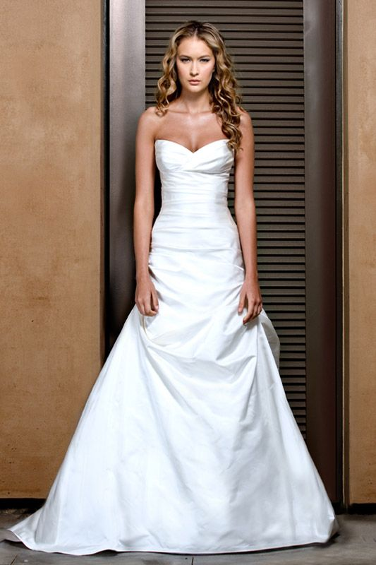 this wedding dress is beautiful and simple