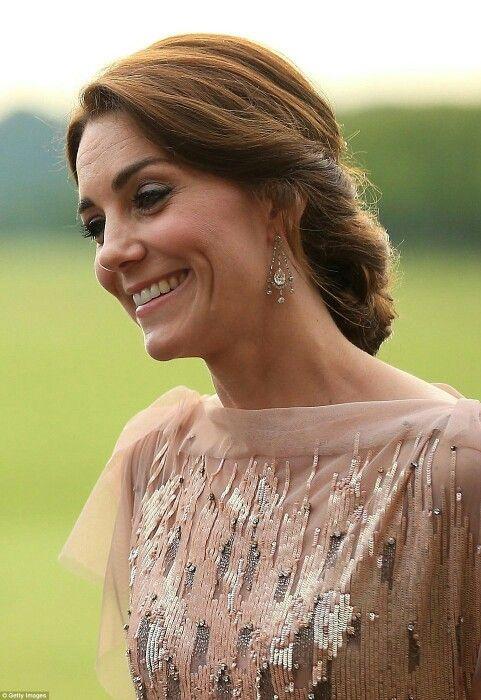 Wearing earrings gifted by QE2