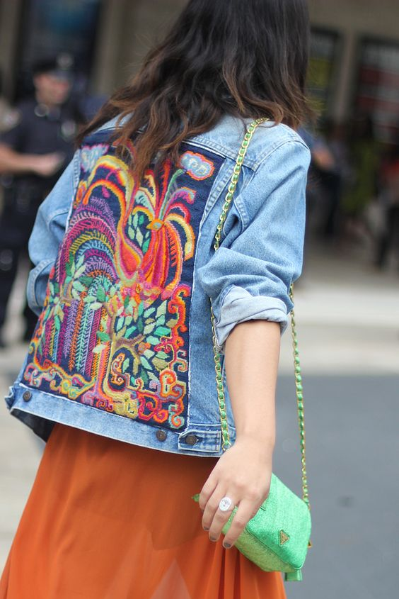 A bright embroidered denim jacket with a girly skirt and pop purse. A fun weekend flea market look.: