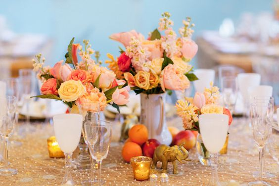peaches and gold mixed with fun elephant figurines.   Photography by heatherwaraksa.com, Event Design and Planning by alwaysabridesmaid.us
