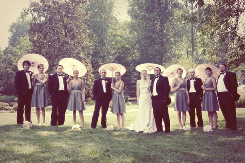 old school shot of wedding party with parasols
