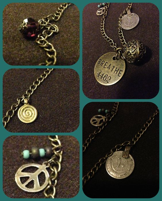 Breathe pendent with corresponding charms in brass colored necklace.  By Renewed Root.