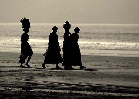 Women going to work at Shrivardhan beach, Maharashtra, India.  These are probably from the fishermen hamlet nearby. It's known as Jivnna bandar or Jivna jetty.  What I did not know at the time of this trip was that I was very close to a confluence of 18°N 73°E.  (Report here.)