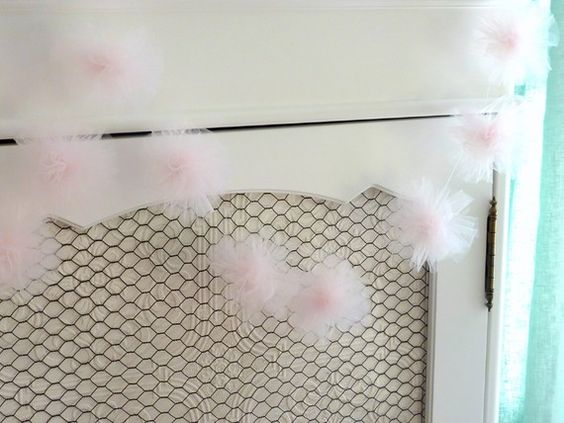 soft pink tulle garland...long strips of tulle folded in half over and over, floral wire to bind the middle, cut the loops at each end and fluff...I made ton of these in pink and blue for B's party