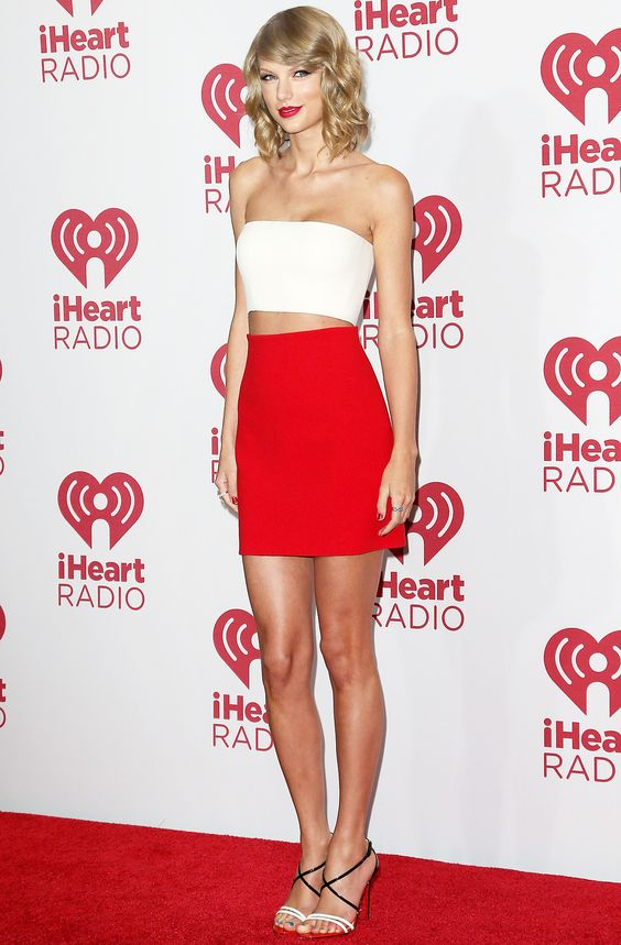 Taylor Swift stole the spotlight in two crop tops at the iHeartRadio Music Festival in Las Vegas on Friday, Sept. 19; see pictures
