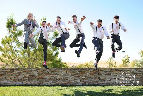 Awesome groomsmen photo! pink socks and suspenders!