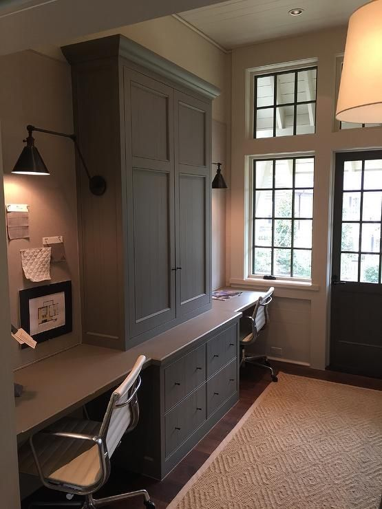 Home Office For Two Features Gray Cabinets Adorned With