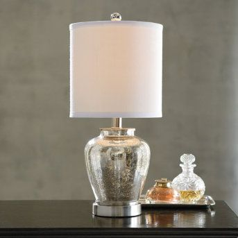 Whether on an entryway or bedside table, our Mercury Glass Lamp will provide vintage warmth and charm to your favorite spaces. This small-scale light fixture has big radiance, a contemporary shape, and an impressive value. The double-walled, silvered-glass base features a distressed patina for an antique look. http://bit.ly/MercuryGlassLamp