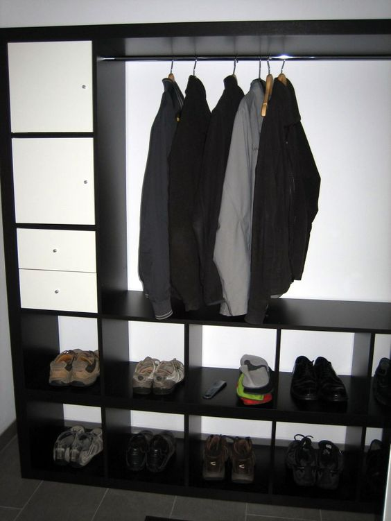 IKEA Hackers: EXPEDIT Wardrobe    You could also cover the whole thing (or just the clothes) with fabric probably