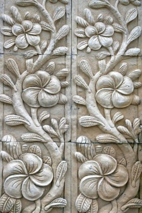 Image detail for flower shape stone carving on wall in
