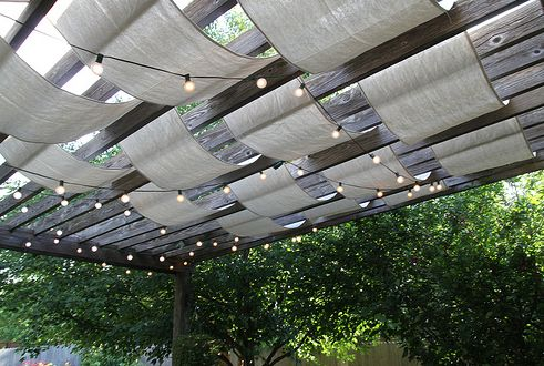 DIY - shade and lights for a deck - www.shelterness.com