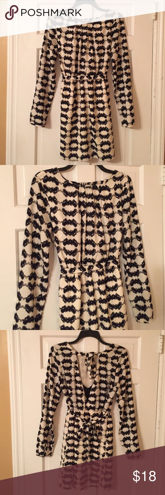 """Black & off white patterned long sleeve dress Adorable black & off white pattern long sleeve polyester dress. Ties in the back around the waist and above the back of the neck. Dress hits just above the knees (I'm 5'4""""). Worn once for a work event! :) Dresses Midi"""