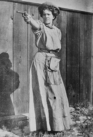 Mrs. Adolph Topperwein. (with gun)