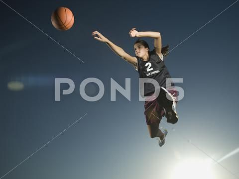 Girl Jumping With Basketball Premium Stock Photo 27945934 Stock Photos Stock Photo Girl Photo