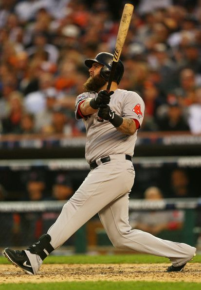 Mike Napoli #12 of the Boston Red Sox hits a seventh inning homerun against the Detroit Tigers during Game 3 of the ALCS.