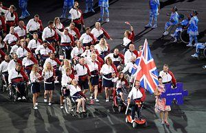 The Great Britain team are led out by flagbearer Lee Pearson