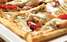 Grilled Chicken Flatbread (Olive Garden) Grilled chicken, mozzarella cheese, roasted red peppers and basil on flatbread crust with alfredo sauce and garlic spread.