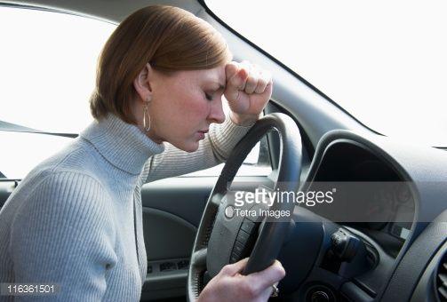 Stock Photo : USA, New Jersey, Jersey City, woman driving car looking upset