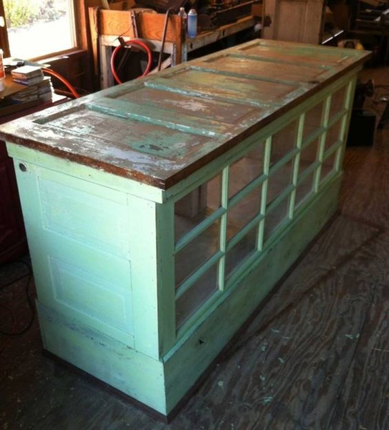 Turn old doors into a kitchen island or cabinet these for Upcycled kitchen cabinets