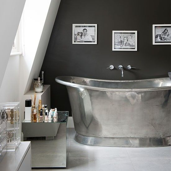 Streamlined attic bathroom with silver roll-top bath Bathrooms don't have to be white you know... the olive-coloured feature wall in this bathroom complements the stainless-steel tub perfectly. Similar bath Catchpole & Rye  Read more at http://www.housetohome.co.uk/room-idea/picture/luxury-bathroom-ideas-10-of-the-best/9#58pfXr4TeJzpkUtu.99: