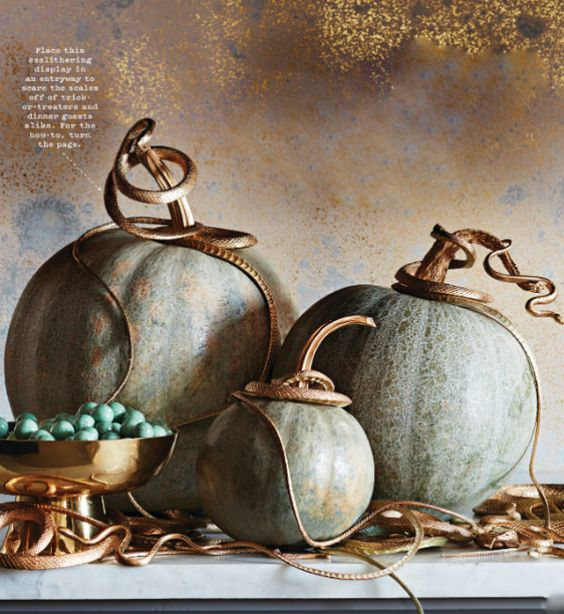 Snake Infested Pumpkins start with a variety of gray, green or white pumpkins, metallic gold paint and inexpensive plastic snakes.