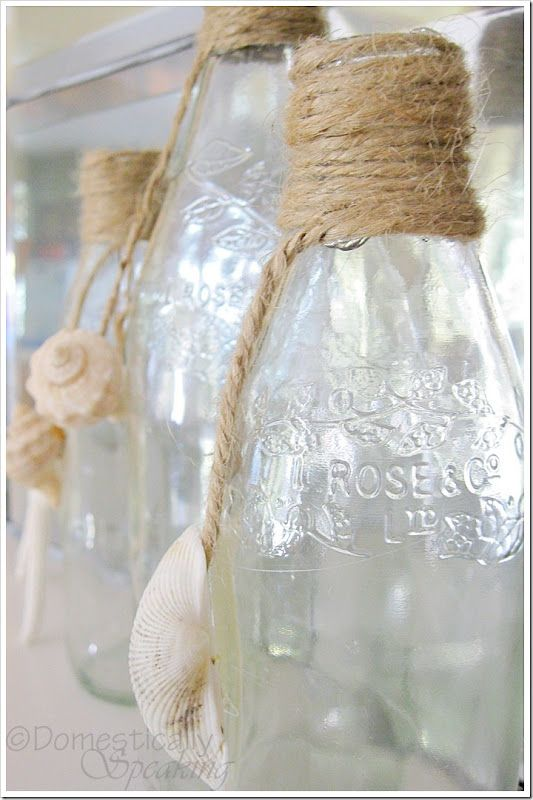 Empty grenadine bottles, shells and twine create cute summer décor bottles