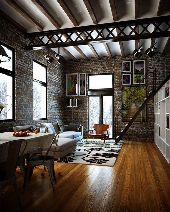 Modern Industrial Style - Deep colors complimented by wood flooring, simple  furniture, and black detailing of stairs and windows.