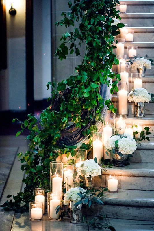 Magical wedding reception decor inspo - staircase lined with greenery + candles + hydrangeas {La Belle Fleur Events}