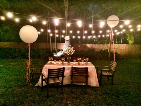 "Michelle's backyard - 36"" balloons, metallic gold spray painted Mason jars with baby's breath & pink flowers, white roses in talk vase, outdoor lighting."