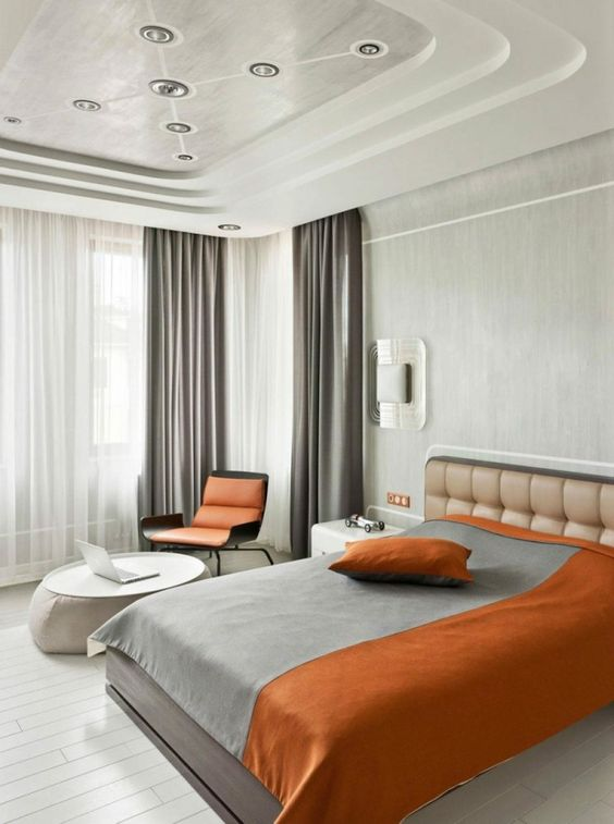home design futuristic ceiling design with orange bedding themes and circula table as workspace