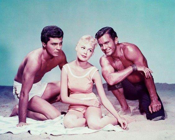 Gidget: Sandra Dee. On her left, James Darren as Moon Doggie. On her right, Cliff Robertson as the Big Kahuna (1959)