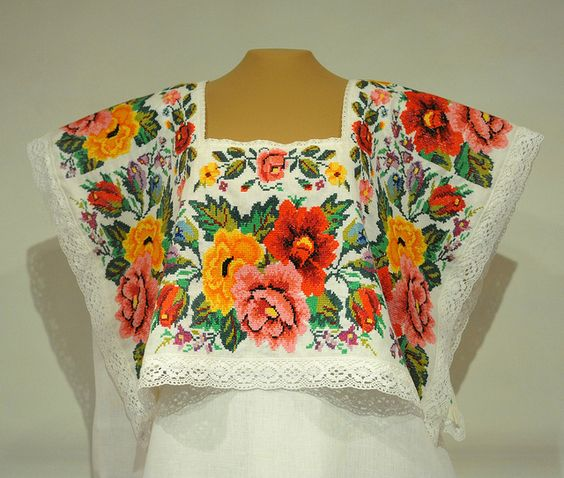 Yucatec Maya Huipil Mexico This terno de lujo or festive huipil (hipil) from Yucatan was one of the pieces of the month on display at the Centro de Textiles del Mundo Maya in San Cristobal de las Casas, Chiapas, Mexico.The flowers are hand-embroidered cross stitch