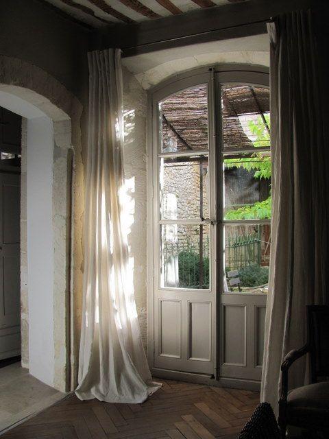 Beautiful light...love doors. love floors. love the courtyard. wow.