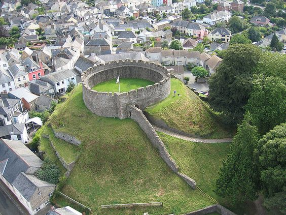 Totnes Castle is one of the best preserved examples of a Norman motte and bailey castle in England. It is situated in the town of Totnes on the River Dart in Devon. The surviving stone keep and curtain wall date from around the 14th century.