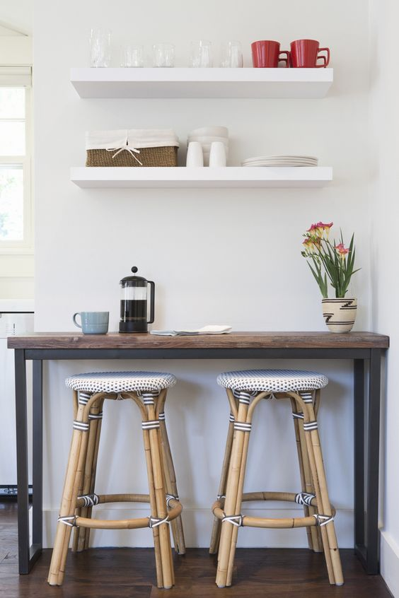Super skinny kitchen table with stools and overhead shelves