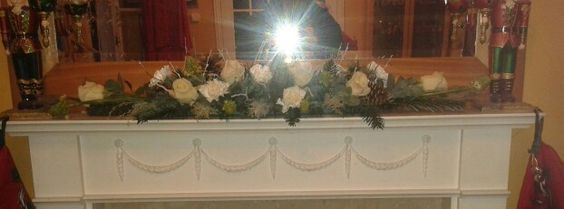 Mama made this her self.  A beautiful mantle runner with white flowers
