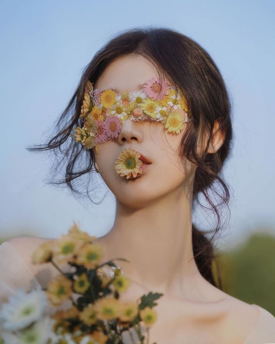 Woman covered in flowers